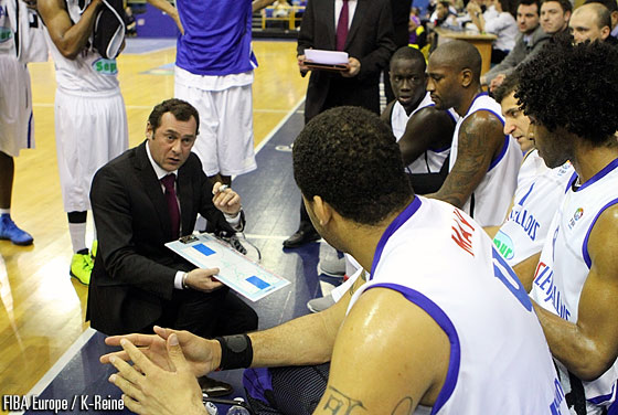 Paris Levallois head coach Christophe Denis addresses his players during a time-out
