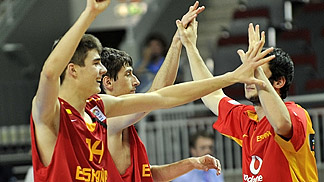 Spain's players celebrate after their quarter-final victory over France